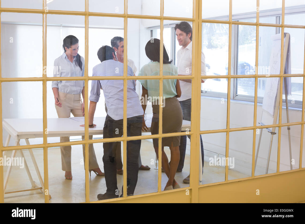 Attractive business people speaking with each other - Stock Image