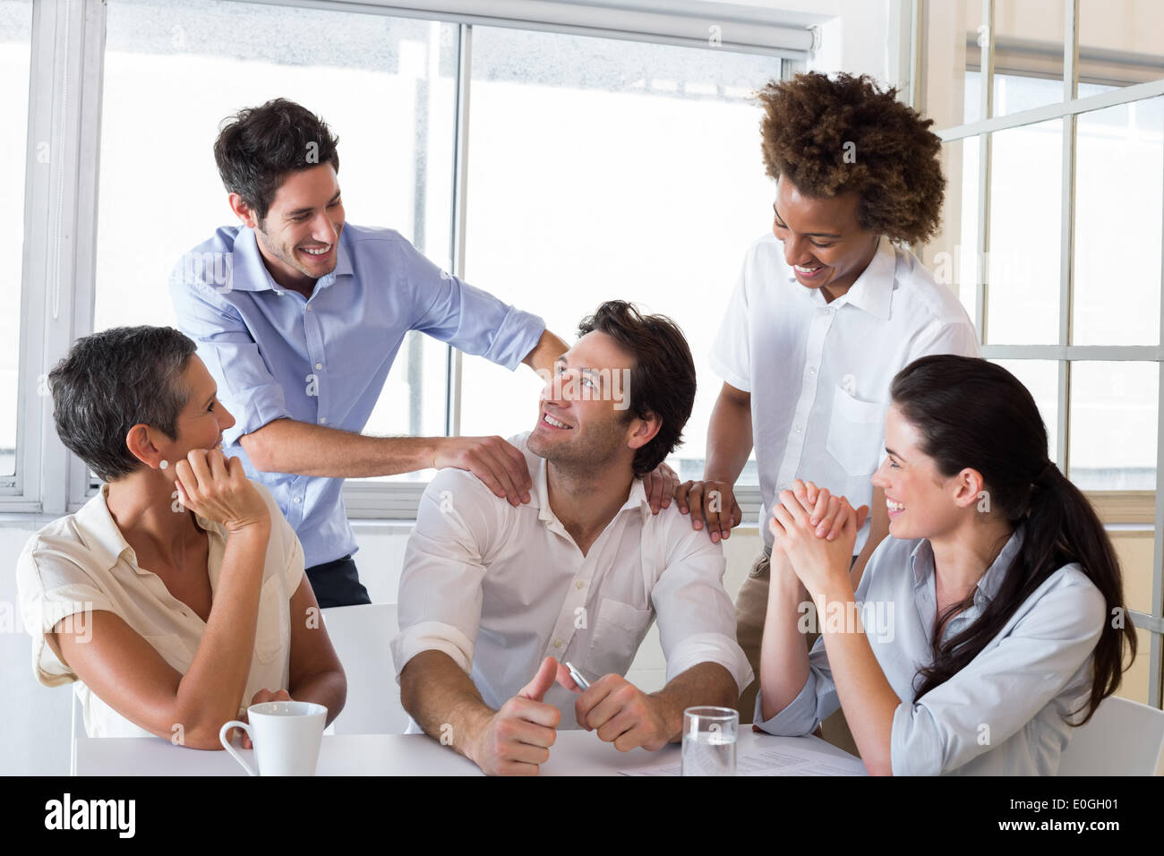 Attractive businessman praising coworker - Stock Image
