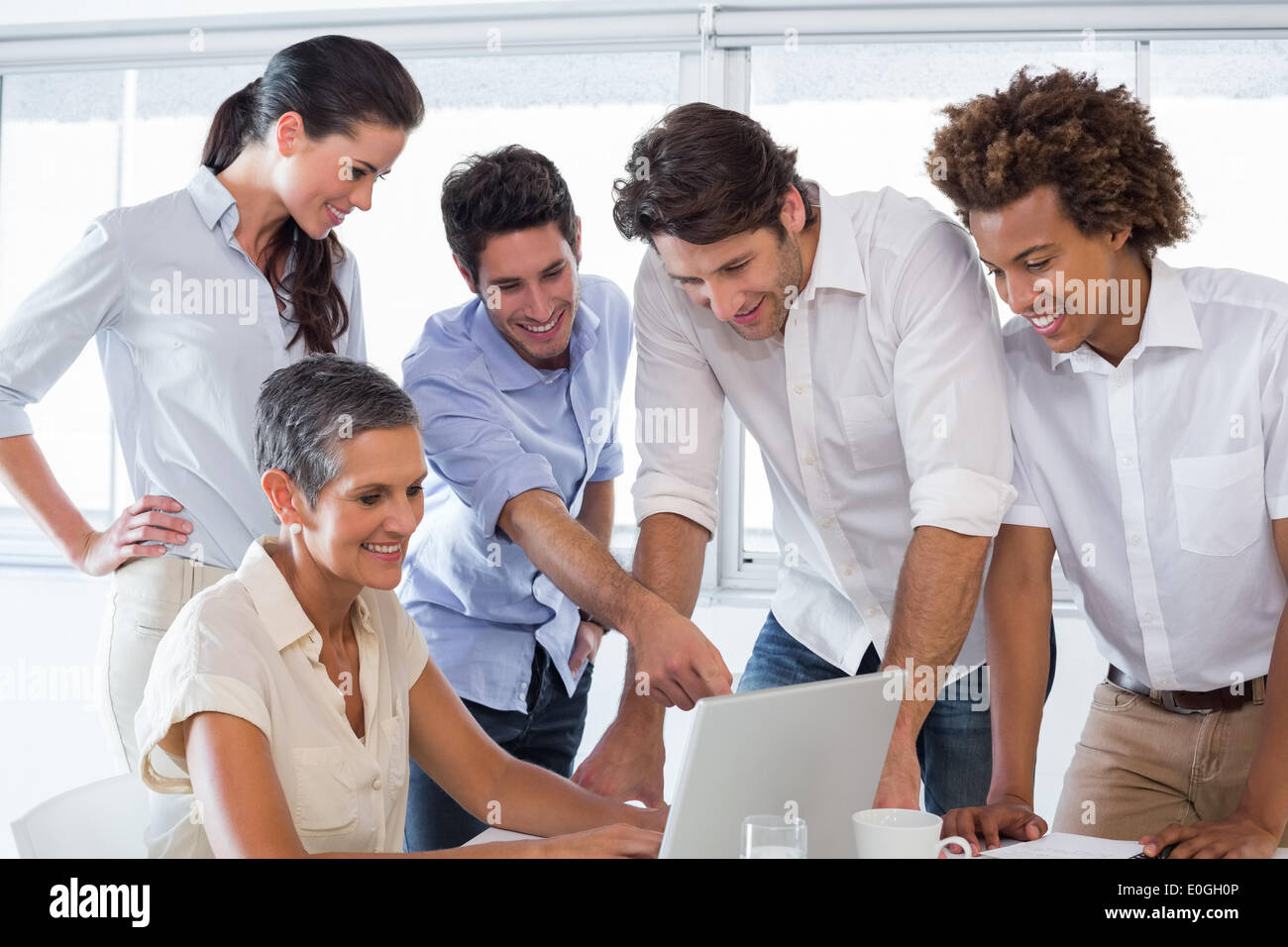 Business people working together on laptop Stock Photo - Alamy