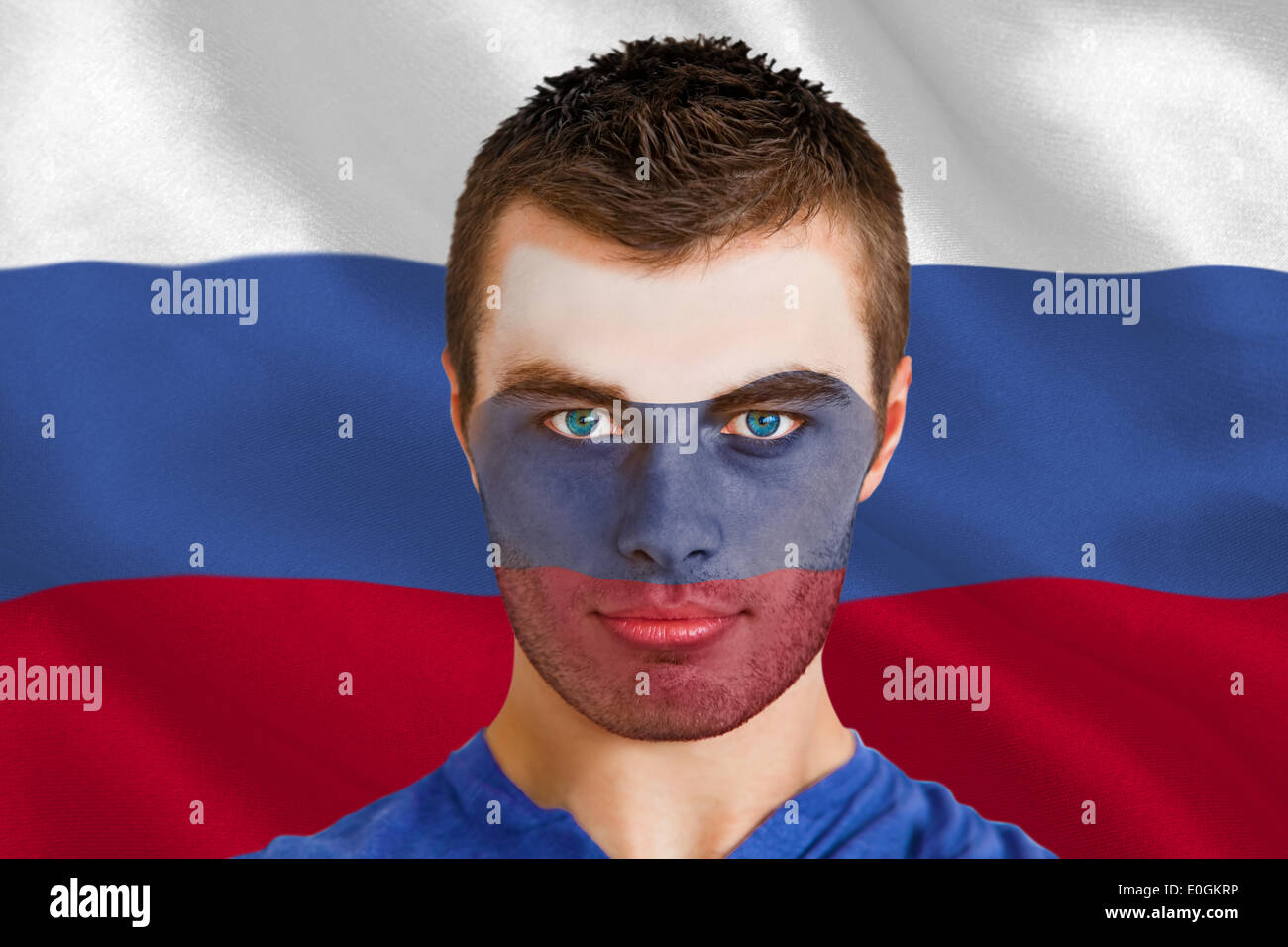 Serious young russia fan with facepaint - Stock Image