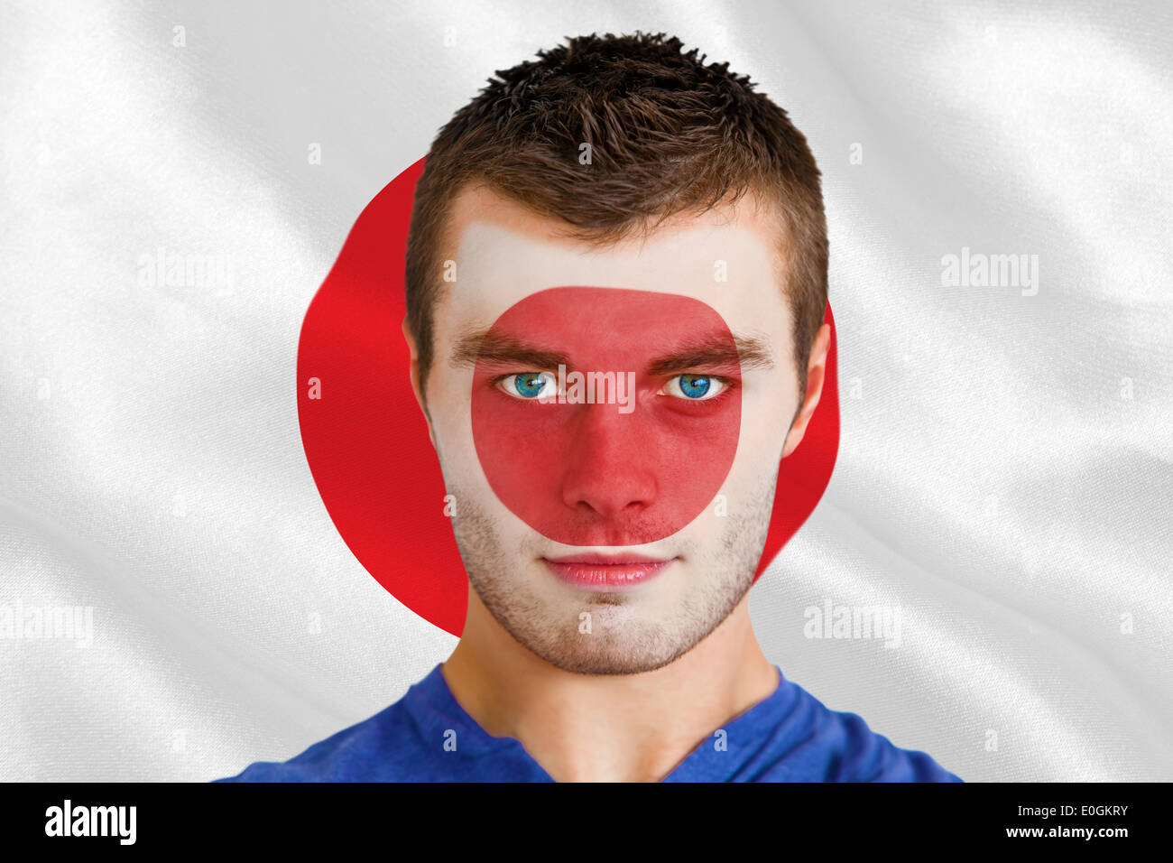 Serious young japan fan with facepaint - Stock Image