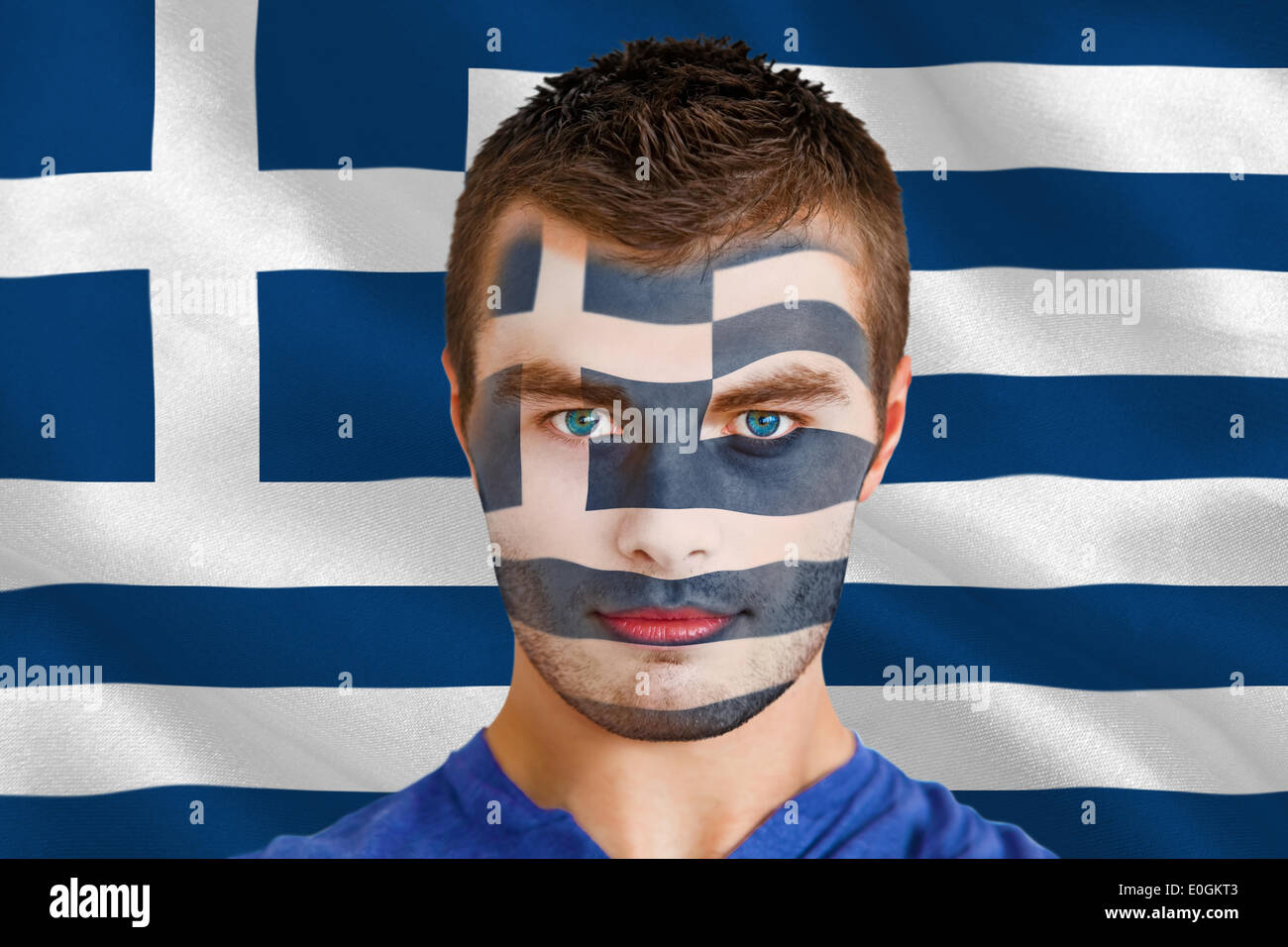 Serious young greece fan with facepaint - Stock Image