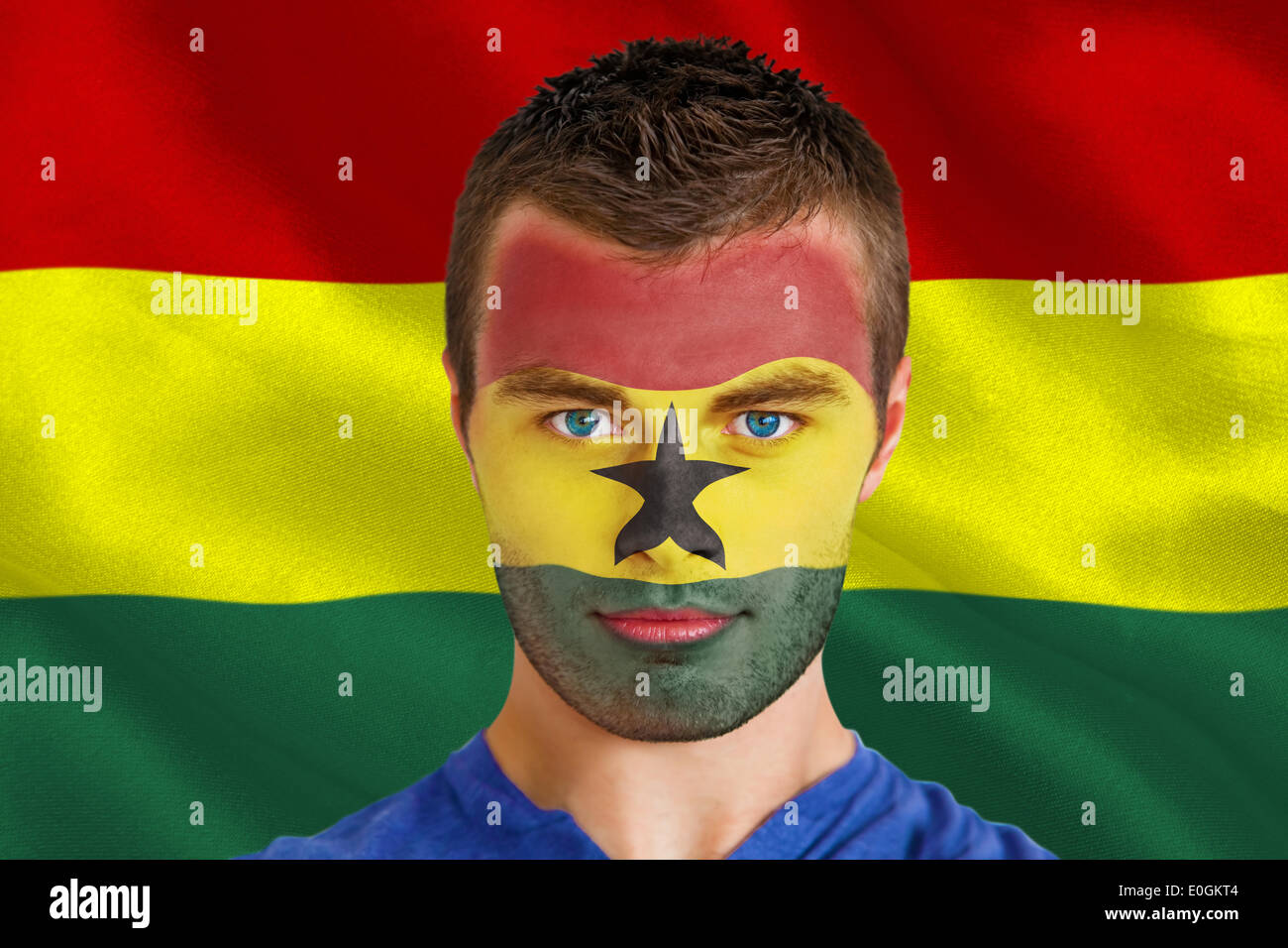 Serious young ghana fan with facepaint - Stock Image