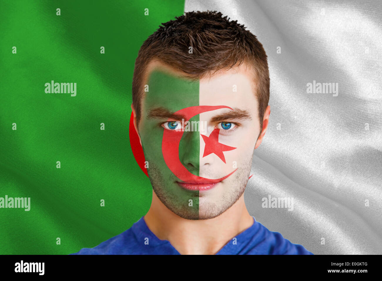 Serious young algeria fan with facepaint - Stock Image