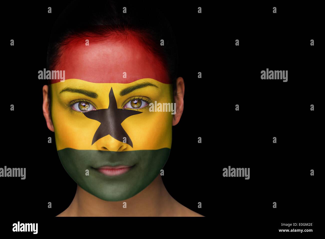 Ghana football fan in face paint - Stock Image