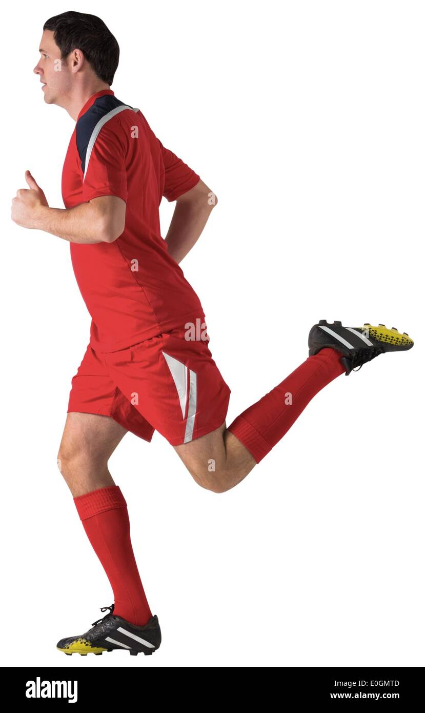 Football player in red running Stock Photo