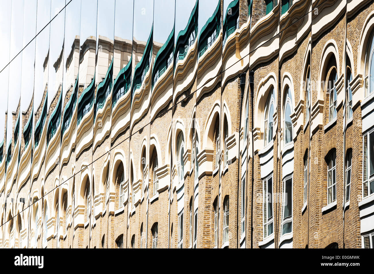 The distorted reflection of a building. - Stock Image