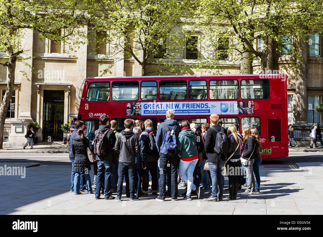 A group of foreign students on a walking tour in London. - Stock Image