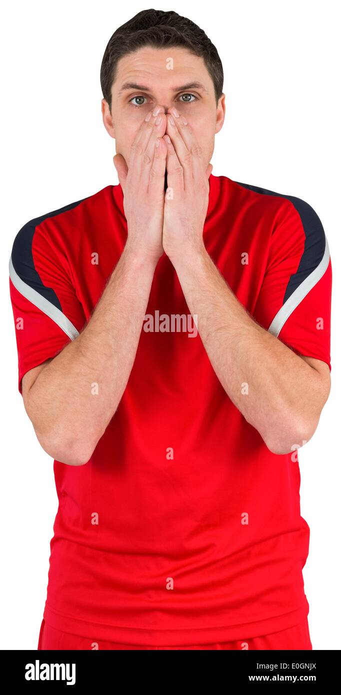 Nervous football player looking ahead - Stock Image