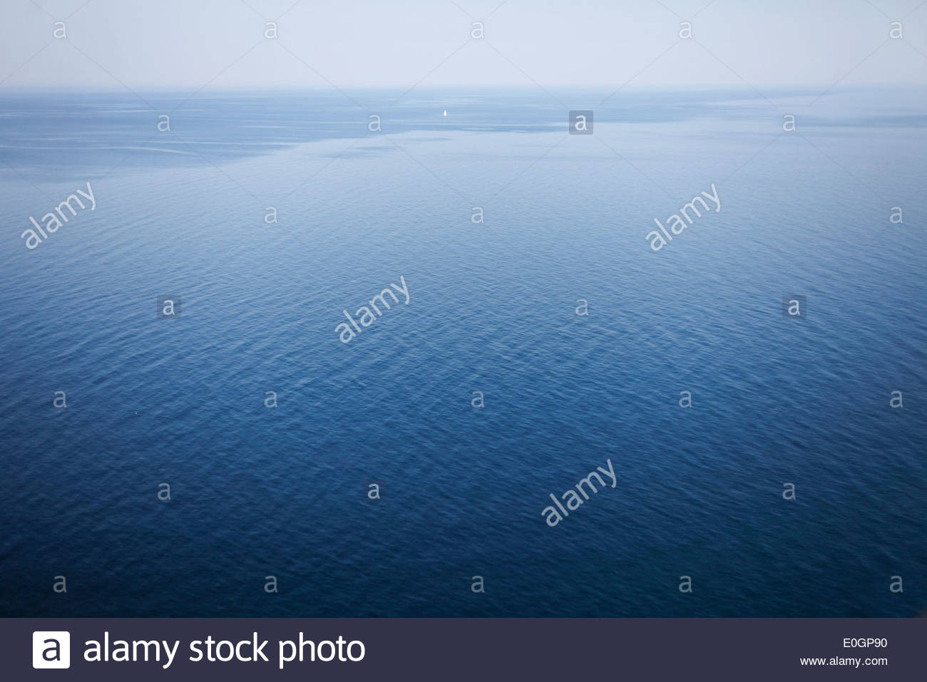 View over Baltic sea, little saling boat, Jasmund Peninsula, Island of Ruegen, Mecklenburg West-Pomerania, Germany - Stock Image