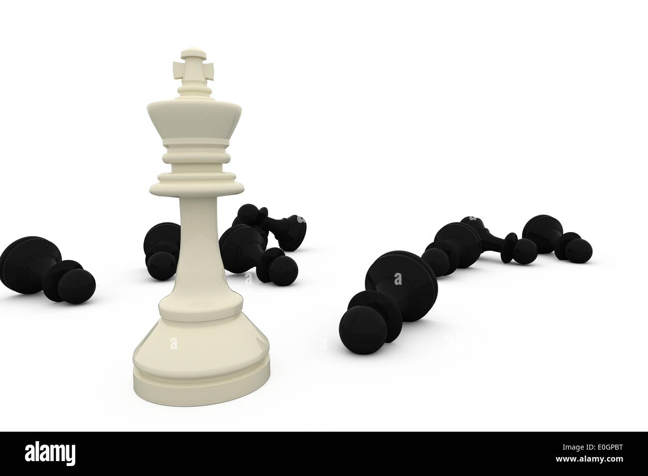 White king standing among fallen black pieces - Stock Image