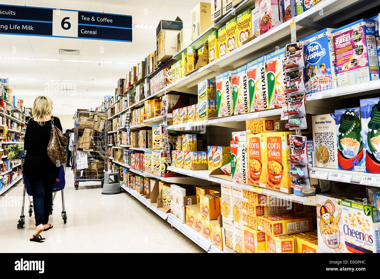 An aisle in a Tesco supermarket in Essex. - Stock Image