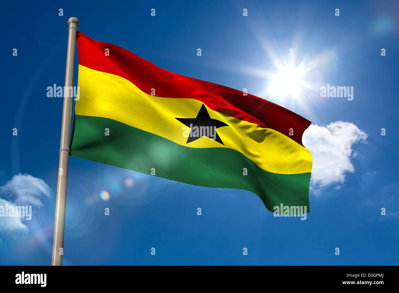 Ghana national flag on flagpole - Stock Image