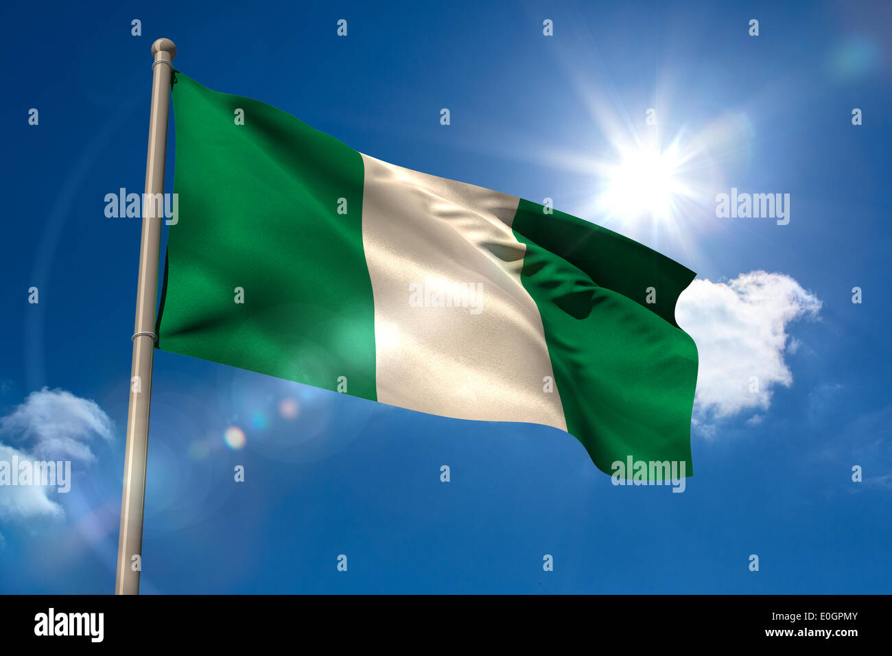 Nigeria national flag on flagpole - Stock Image