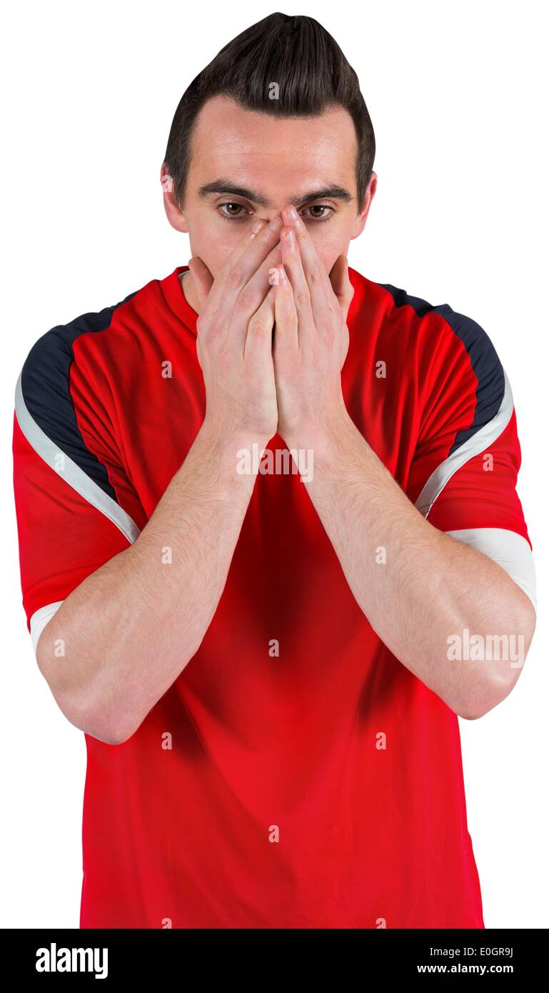 Nervous football fan looking ahead - Stock Image