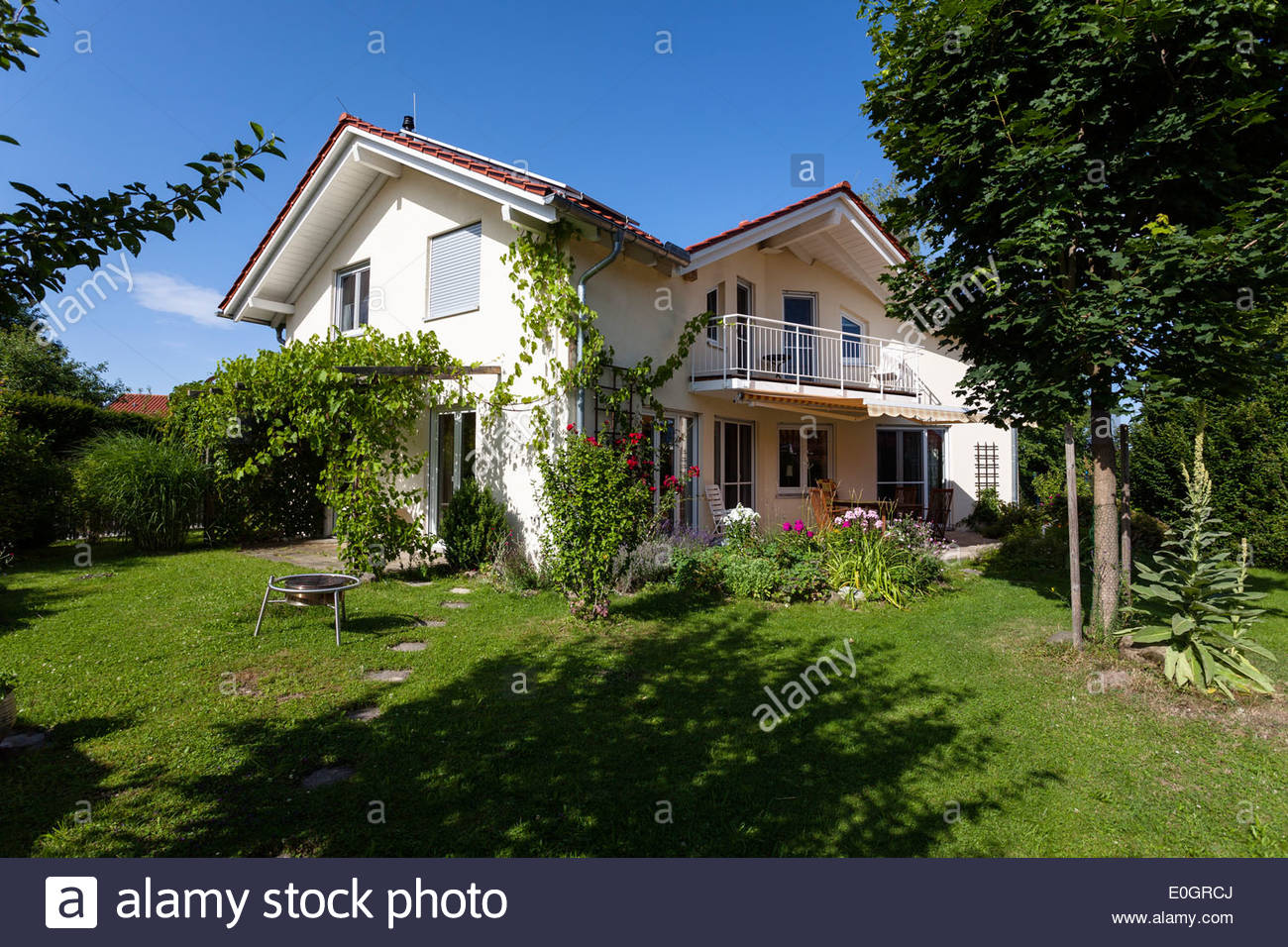 detached family house with garden in summer, Upper Bavaria, Germany - Stock Image