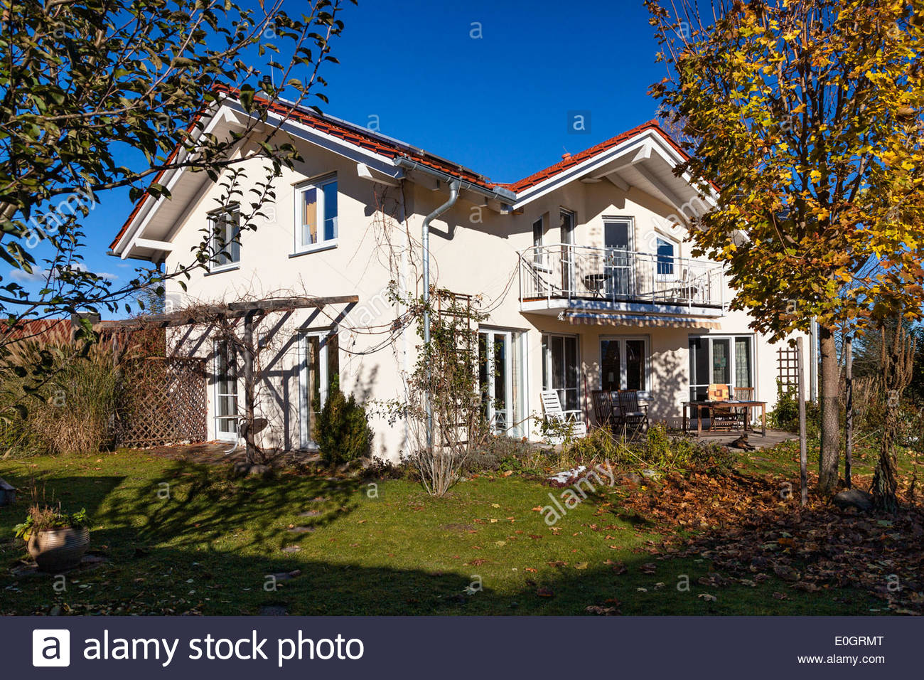 Detached family house with garden in autumn, Upper Bavaria, Germany - Stock Image