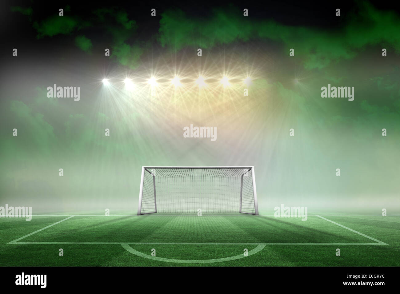 Football pitch and goal under spotlights - Stock Image