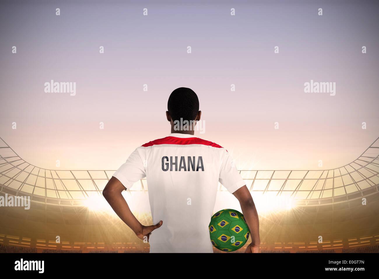 Ghana football player holding ball - Stock Image