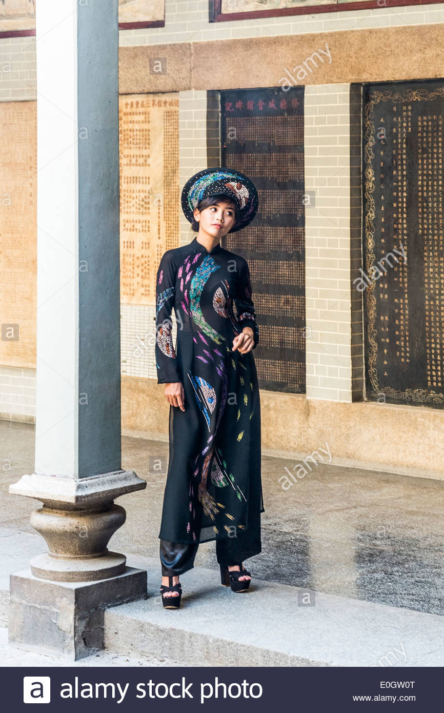Young woman wearing fashionable traditional clothes in the Thien Hau pagoda in Saigon, south Vietnam, Vietnam, Asia - Stock Image