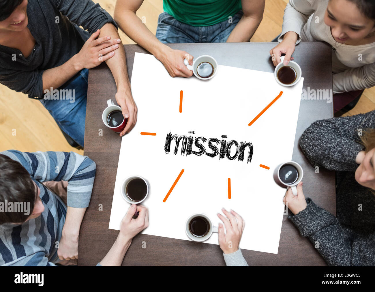 Mission on page with people sitting around table drinking coffee - Stock Image