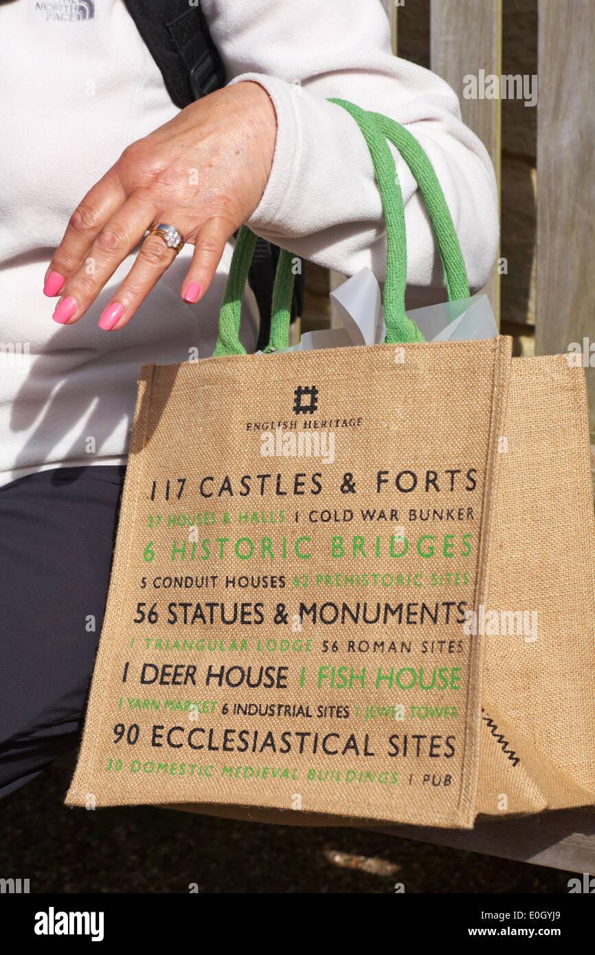 woman holding an English Heritage bag - Stock Image