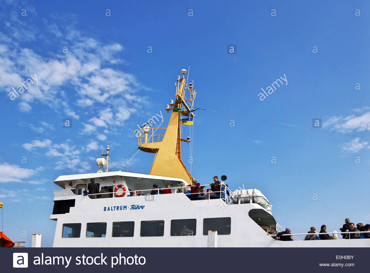 Passengers bound for Insel Baltrum, one of Germany's East Frisian islands on the North Sea coast, await departure Stock Photo