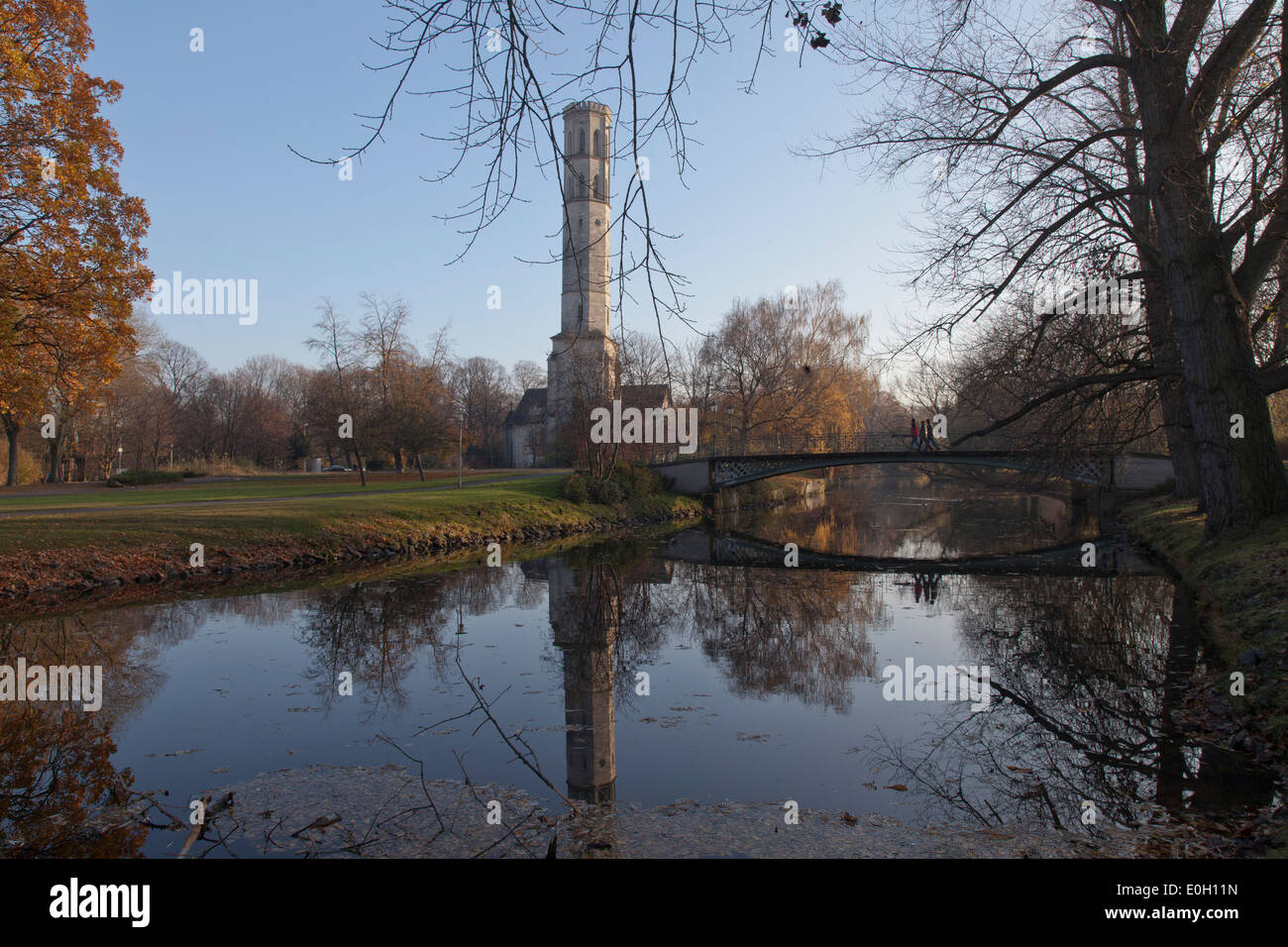 Pond in Brunswick park with decorated chimney, city park, Brunswick, Lower Saxony, Germany - Stock Image
