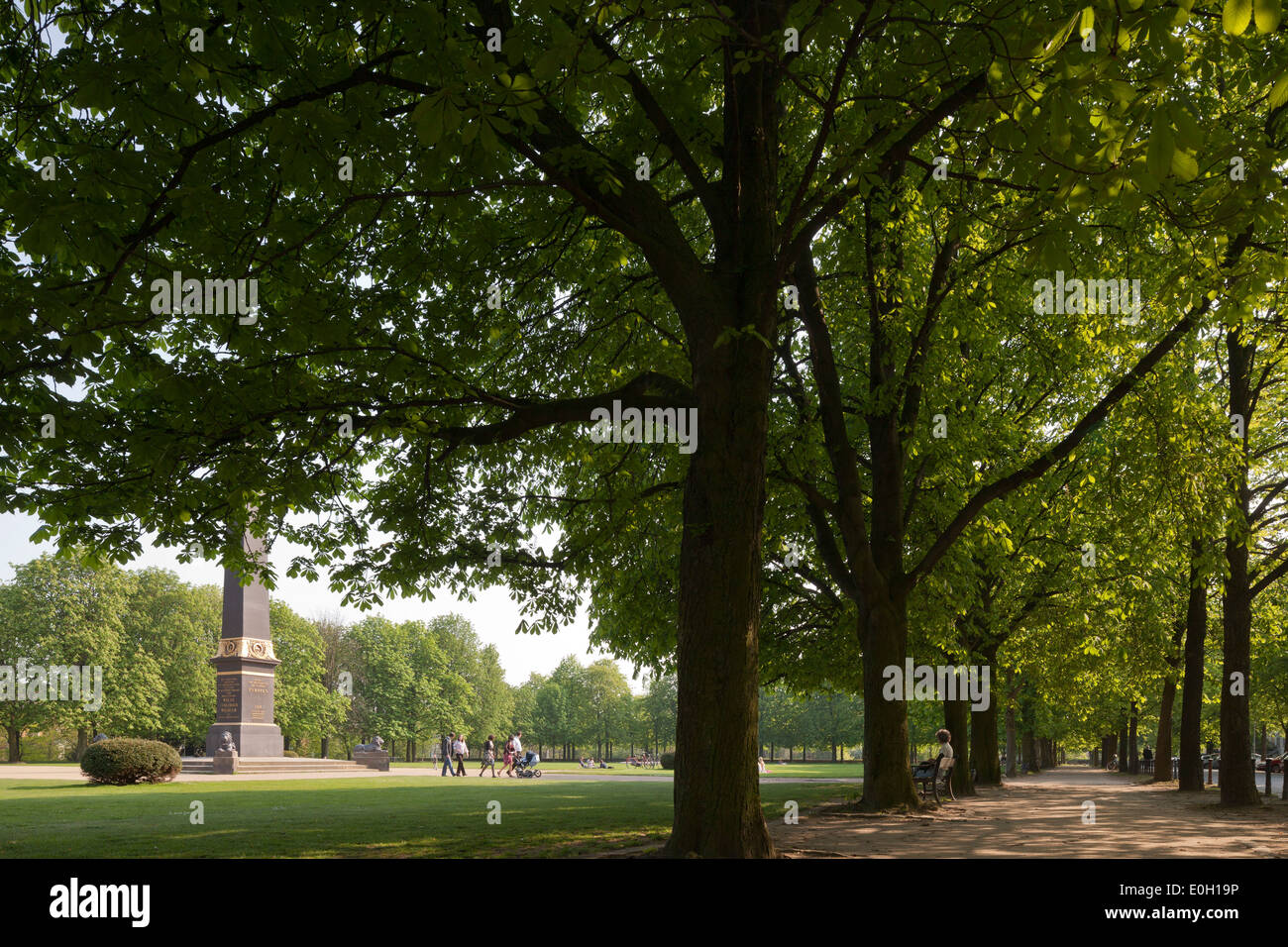 Monument with park lawn surrounded by chestnut trees, Lion wall, Green belt Brunswick, Lower Saxony, Germany - Stock Image