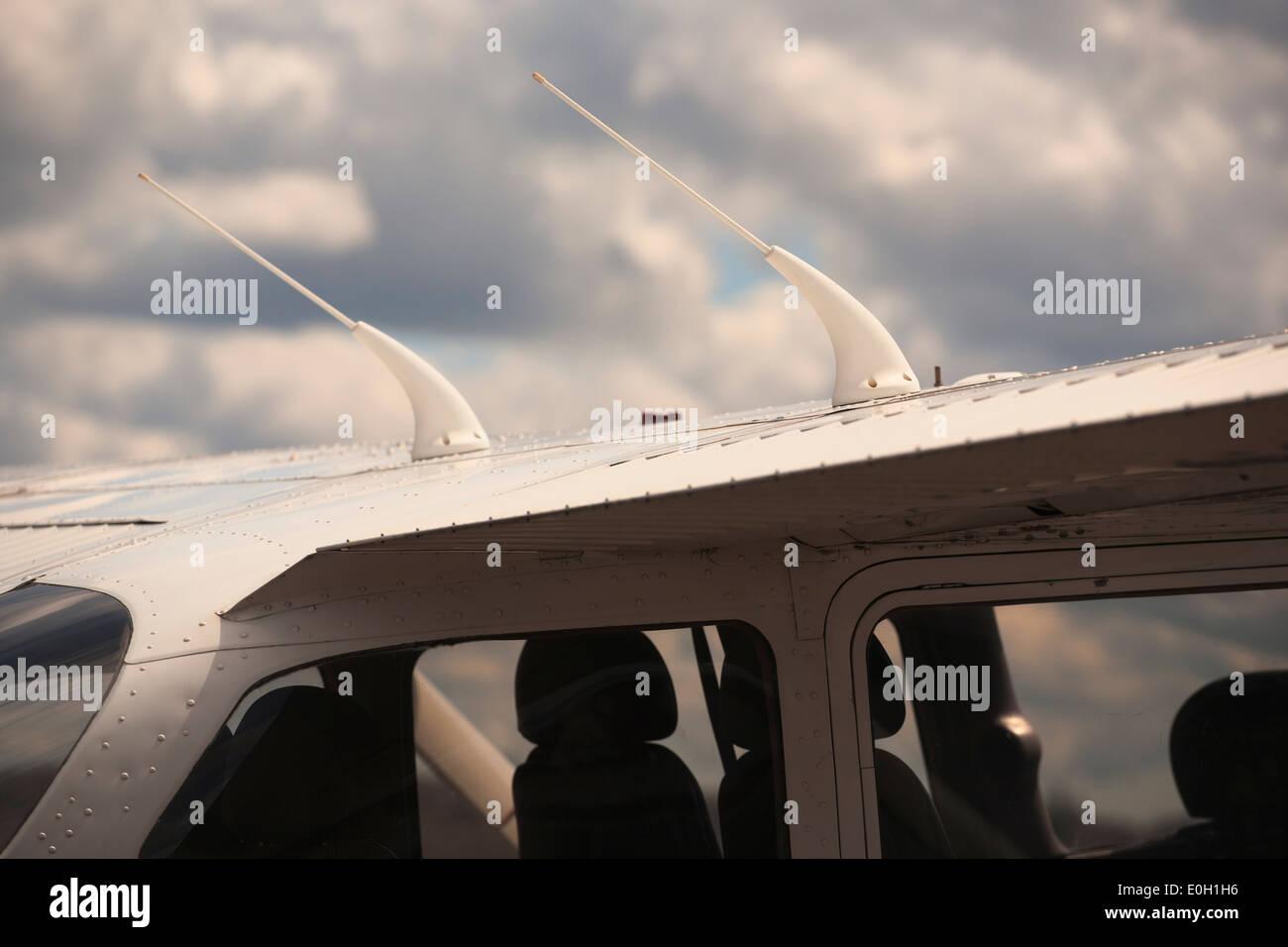Cessna 172 VHF antennas on wing - Stock Image