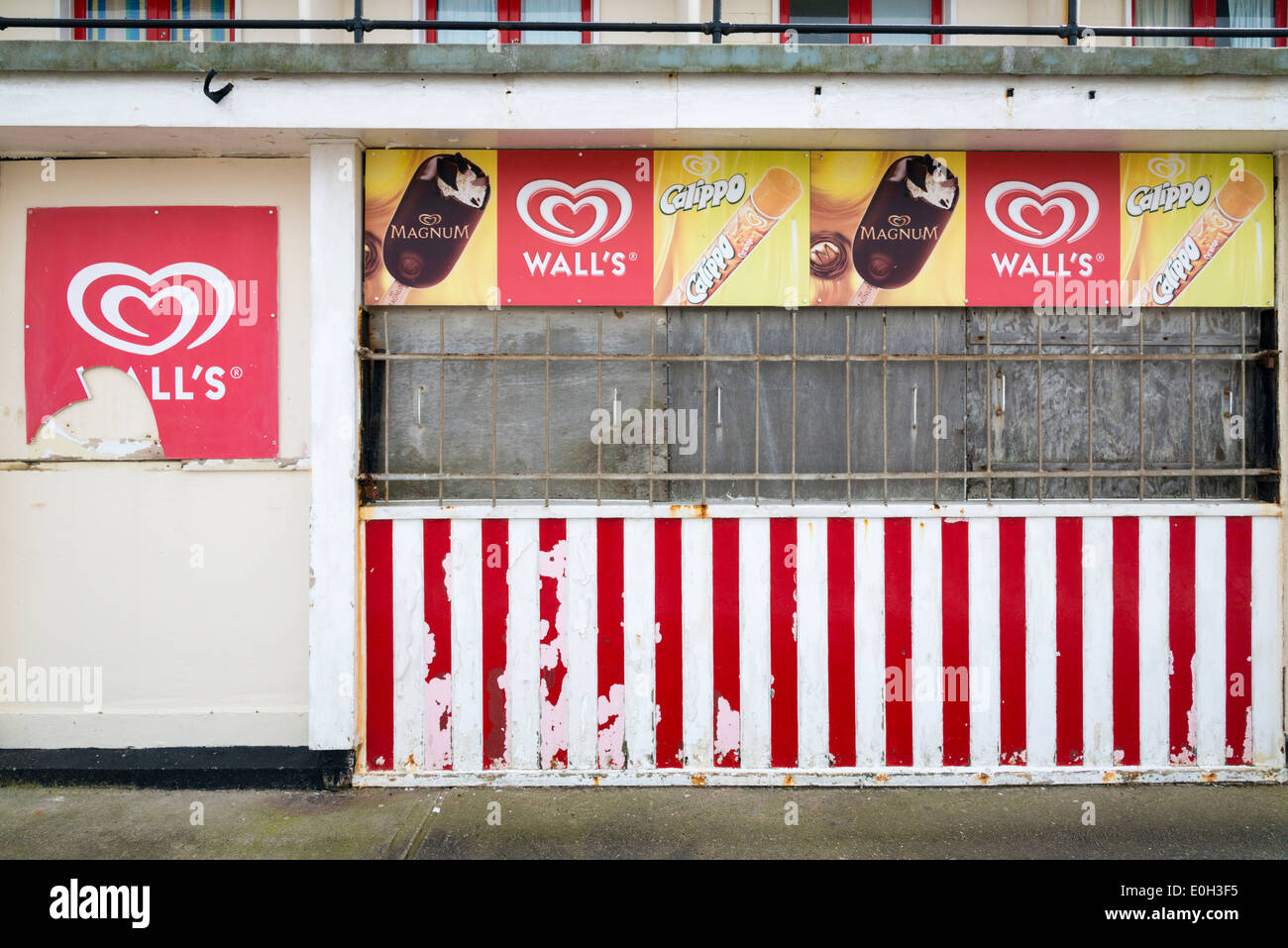 A closed and run down Wall's Ice cream parlour or kiosk on the promenade of the seaside town of Sheringham Norfolk Stock Photo