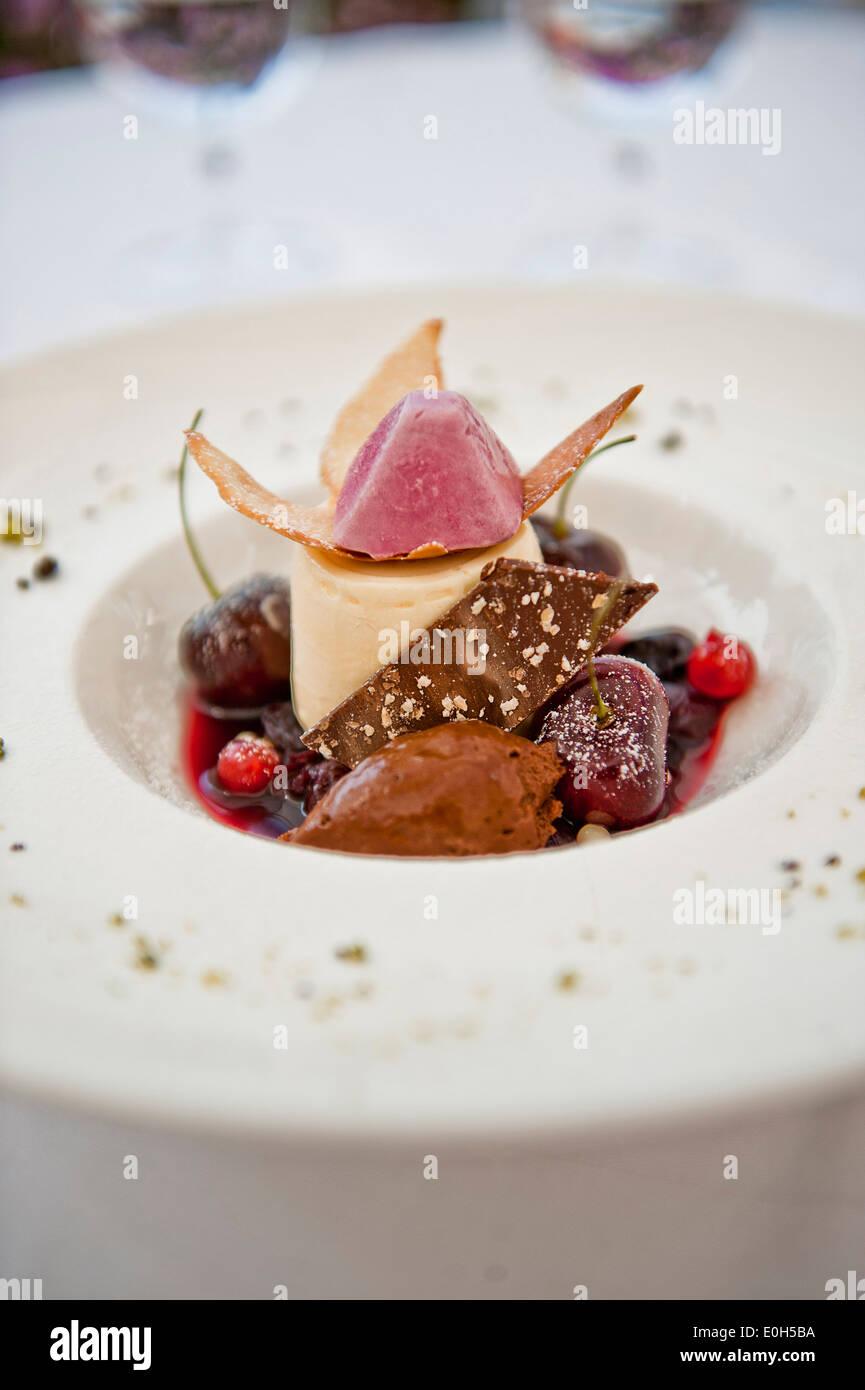 Desert variation, Panna Cotta and Mousse au Chocolat with cherries, Hotel Castagnola, Lake Lugano, Lugano, Ticino, Switzerland - Stock Image