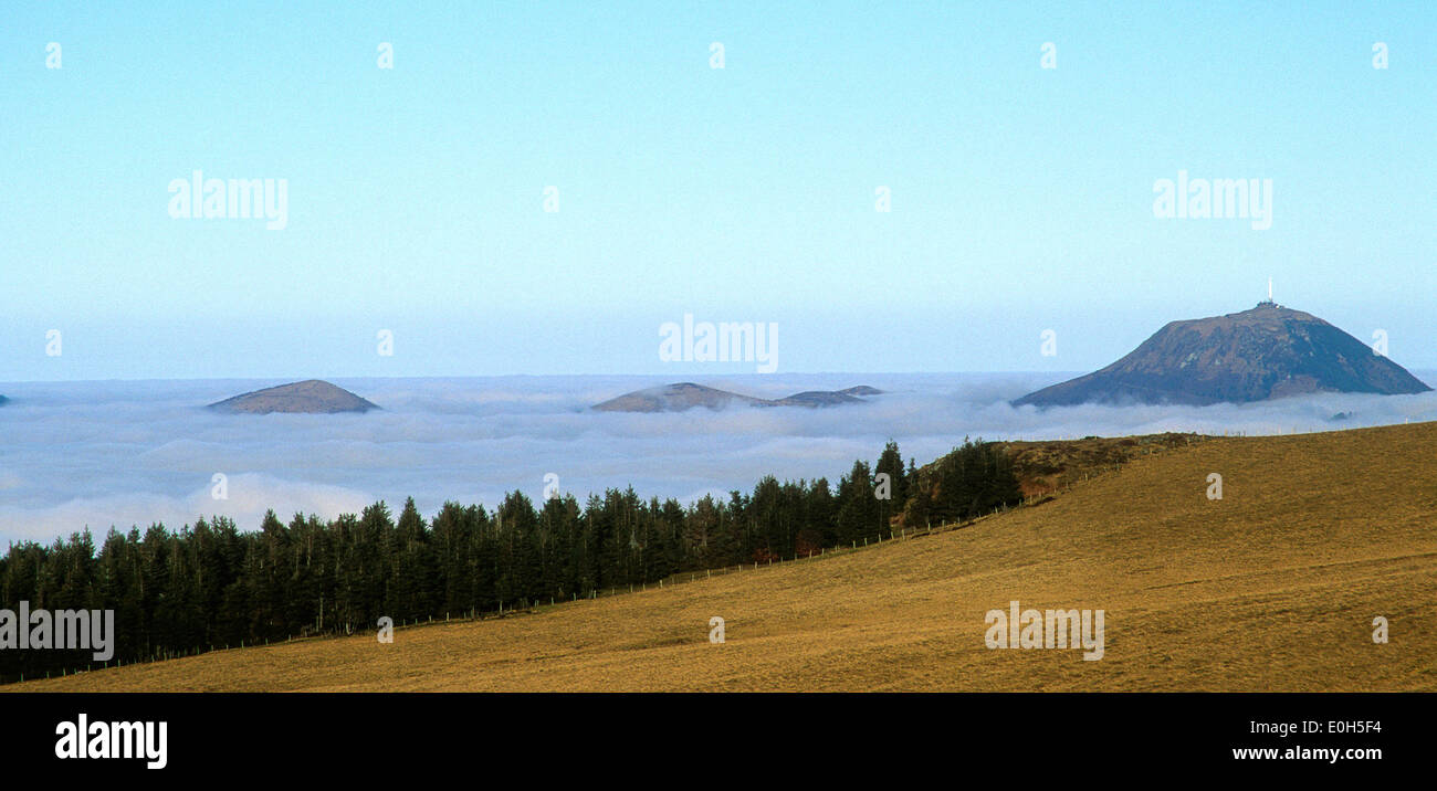 Puy de Dome mountain volcano top summit in the mist, Auvergne, France - Stock Image