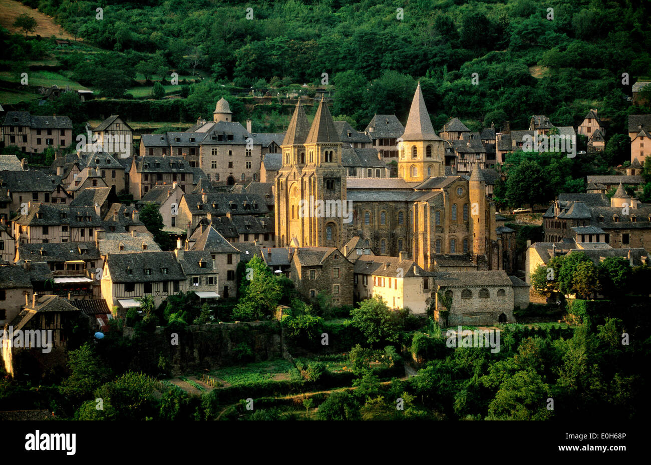 Abbatiale Sainte Foy abbey church on the Way of St. James in Conques village, Aveyron, Midi-Pyrenees, France - Stock Image