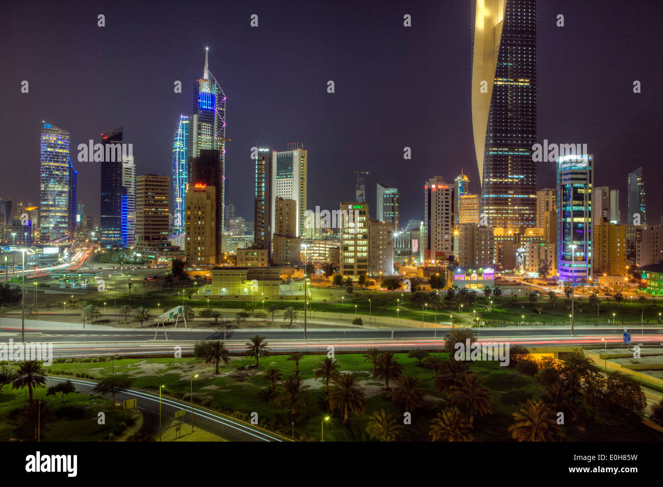 Arabian Peninsula, Kuwait, city skyline and central business district, elevated view at night Stock Photo
