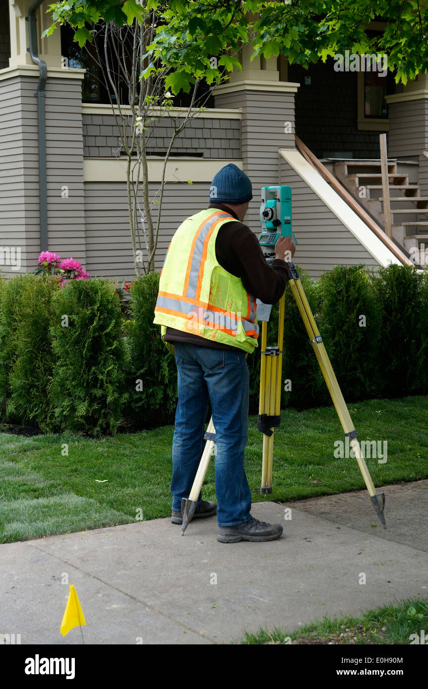 Surveyor using a digital theodolite, Vancouver, BC, Canada - Stock Image