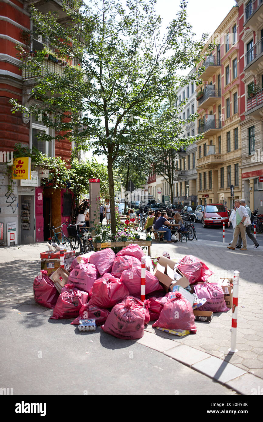 Typical red hamburgian garbage bags, rubbish bags, corner of Glasshuettenstrasse and Marktstrasse, Karolinen district, Hamburg, - Stock Image