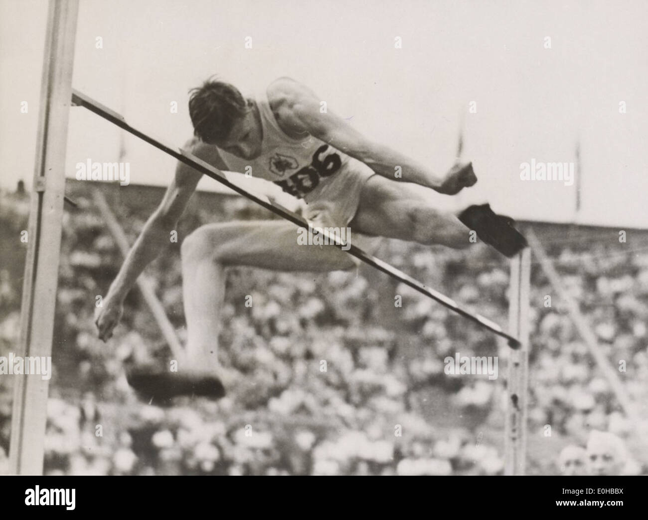 Athlete John Winter winning the high jump event at the London Olympic Games, August 1948. - Stock Image