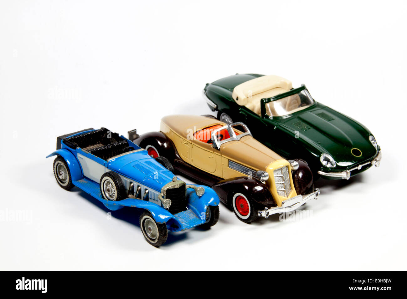 collection of three toy model cars on white - Stock Image