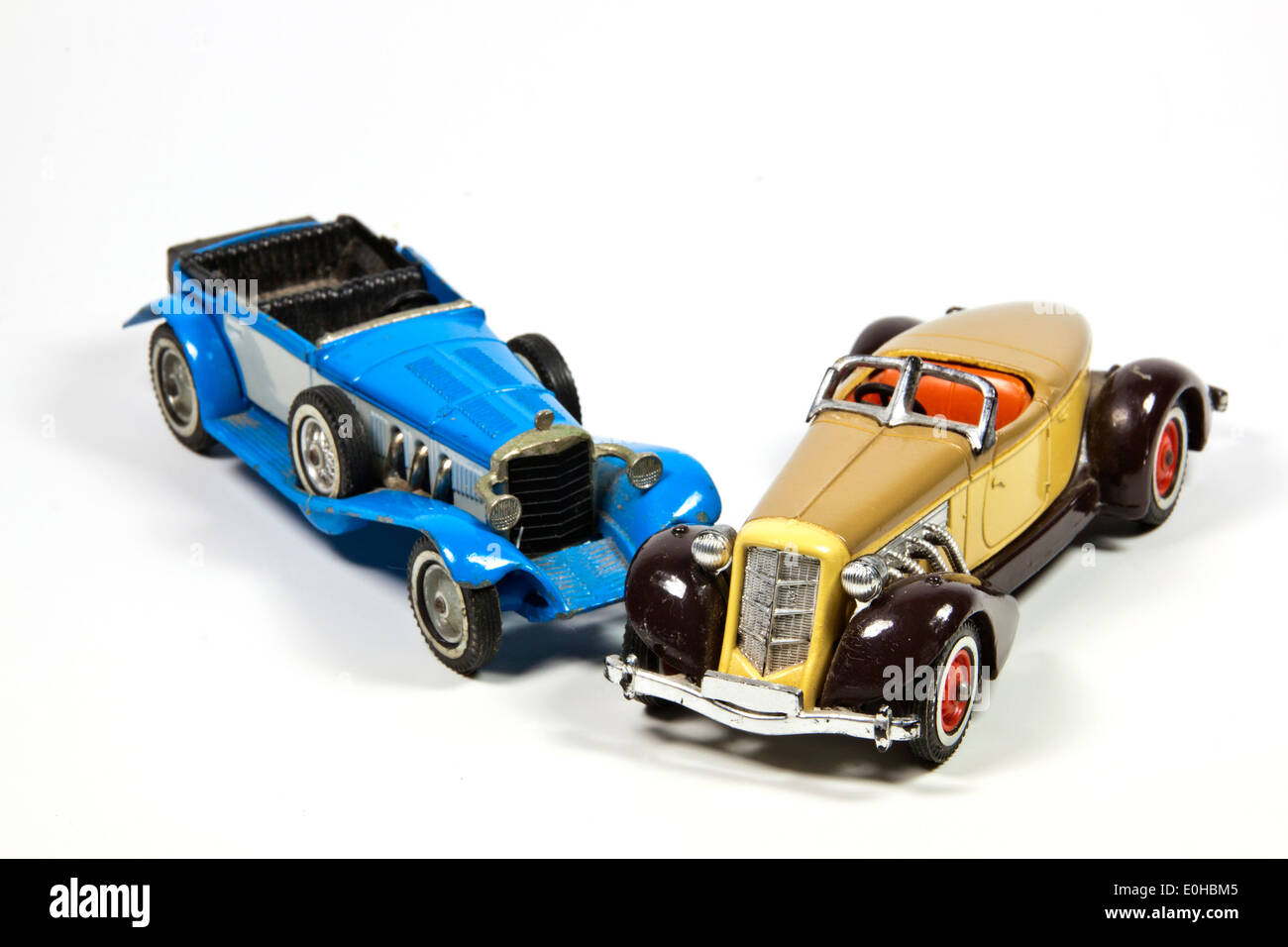 two vintage toy model cars on white - Stock Image