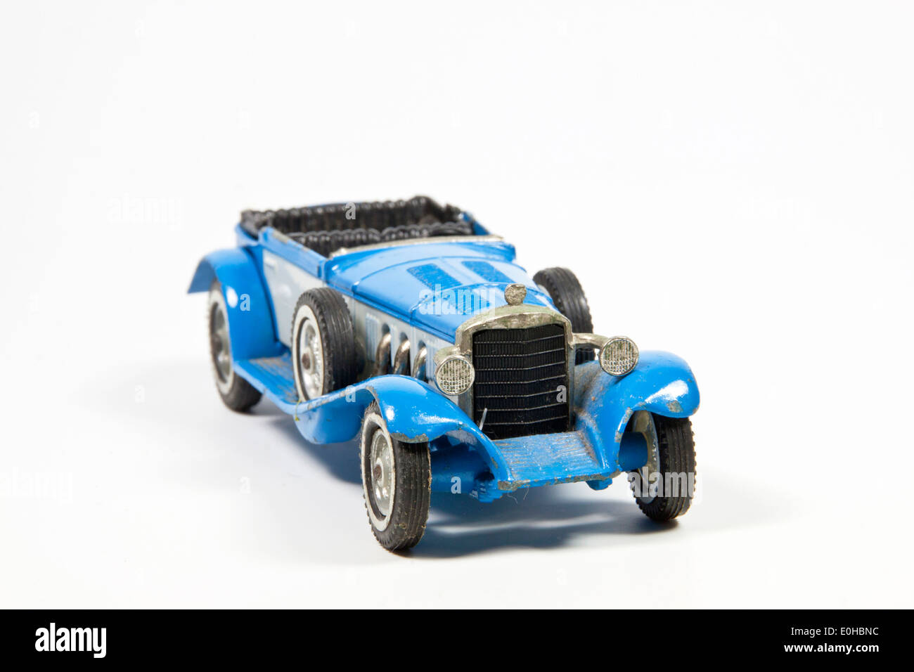blue toy vintage model car on white - Stock Image