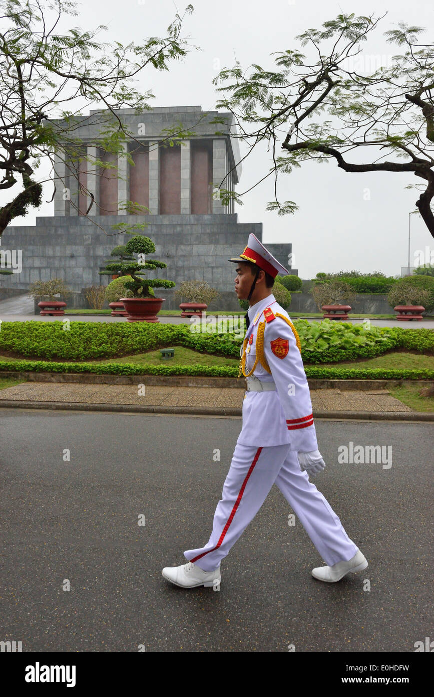 Off duty Guardsmen dressed in white uniform walking past Ho Chi Minh Mausoleum the historic place where Respected Uncle Ho lies. - Stock Image