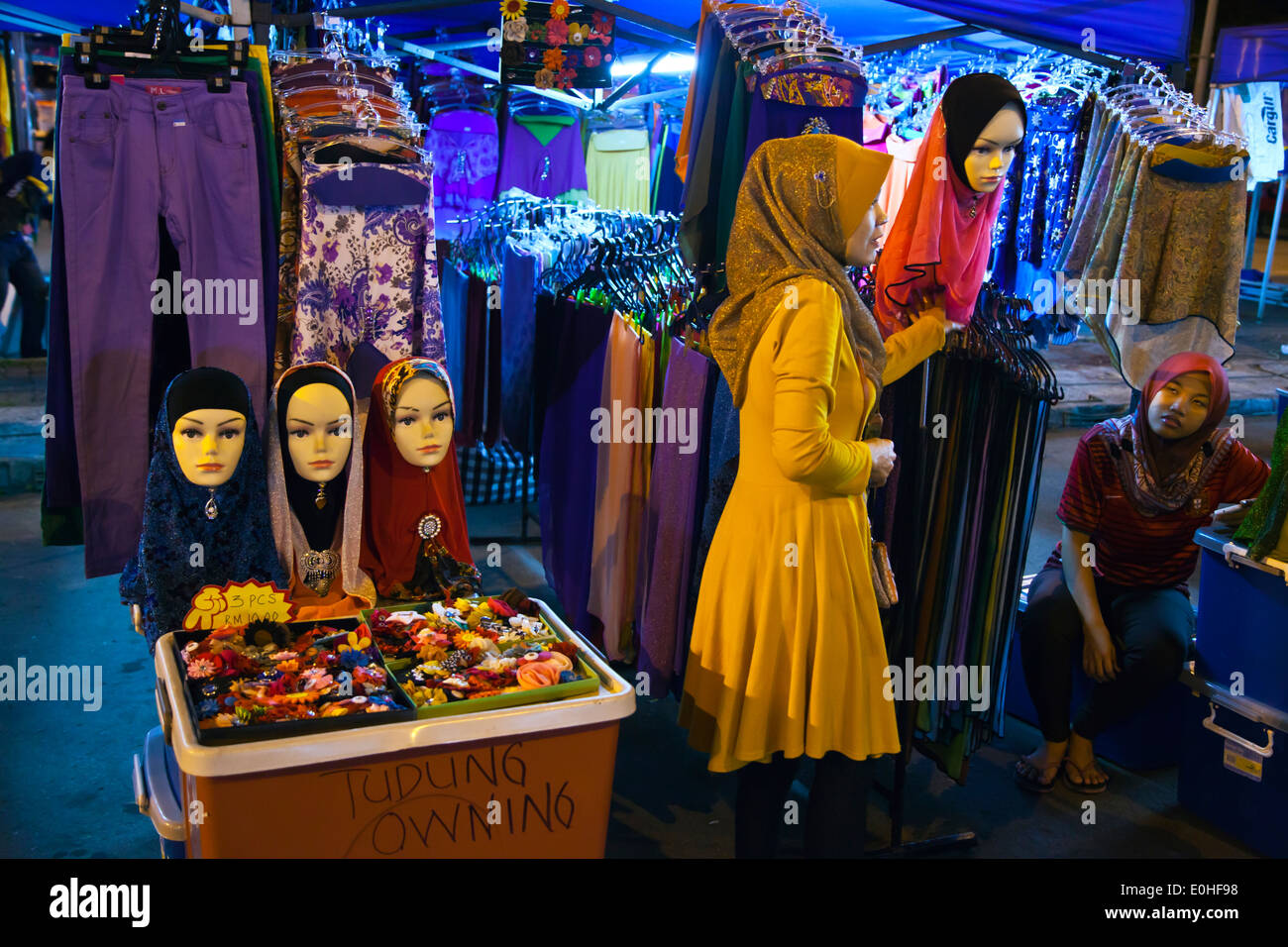 HEAD SCARVES for Muslim women for sale in the KOTA KINABALU NIGHT MARKET - SABAH, BORNEO, MALAYSIA - Stock Image