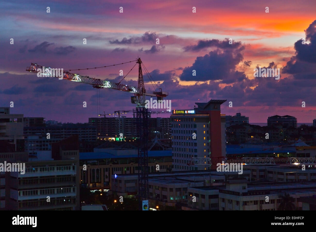The skyline of the city of KOTA KINABALU at sunset - SABAH, BORNEO, MALAYSIA - Stock Image