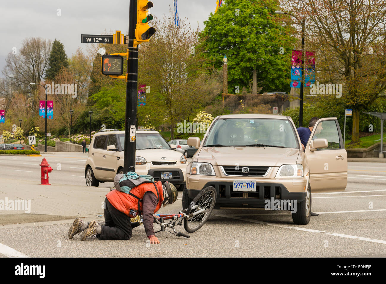 Aftermath of accident in intersection involving a cyclist. Cyclists fall not witnessed. No fault to any party implied. - Stock Image
