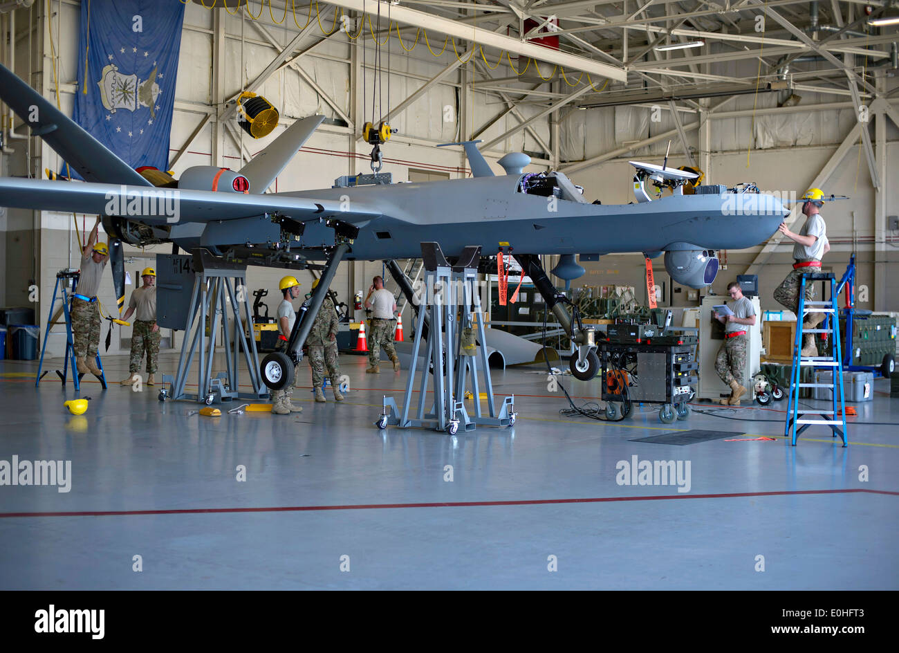 US Air Force airman from Canon Air Force Base assemble an MQ-9 Reaper unmanned aerial vehicle April 23, 2014 at Hurlburt Field, Florida. - Stock Image