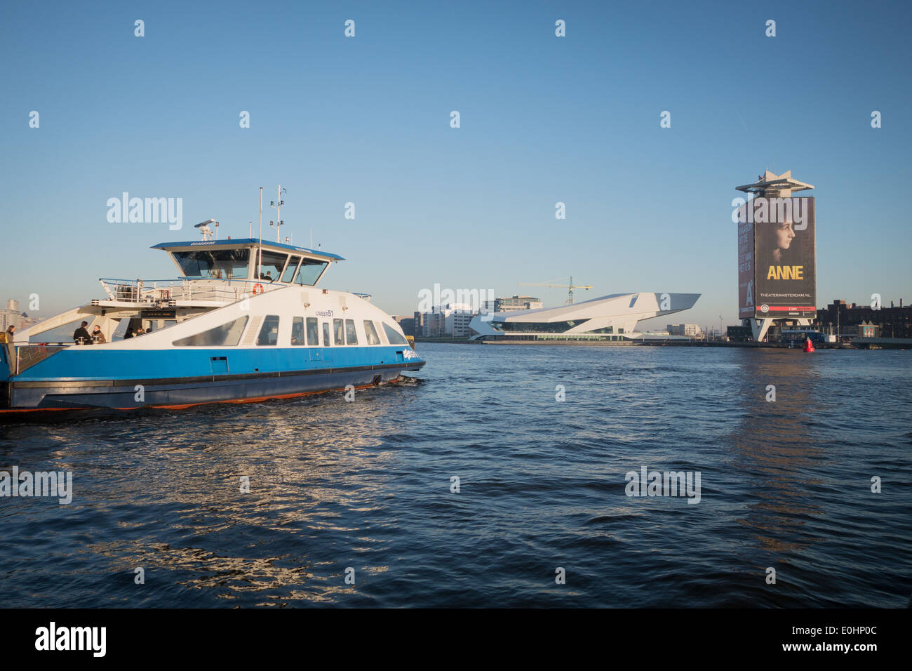 The ferry across the IJ River to Amsterdam North Noord with the Eye Film Museum and shell tower - Stock Image