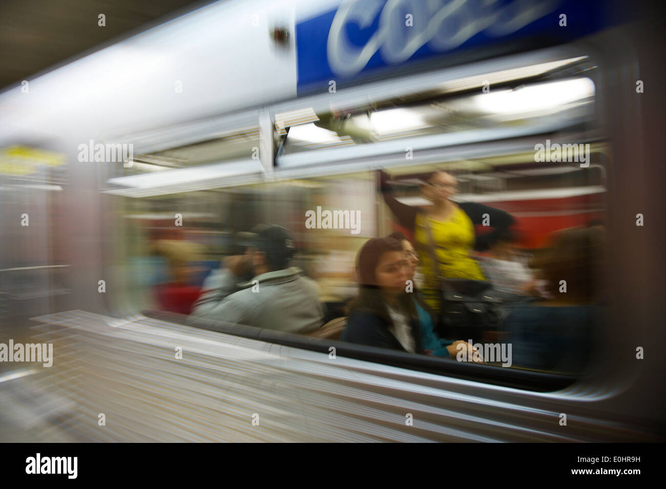 SAO PAULO, BRAZIL - SEPTEMBER 28, 2013: Commuters ride the Metropolitano de Sao Paulo, which carries over 7 million passengers. - Stock Image