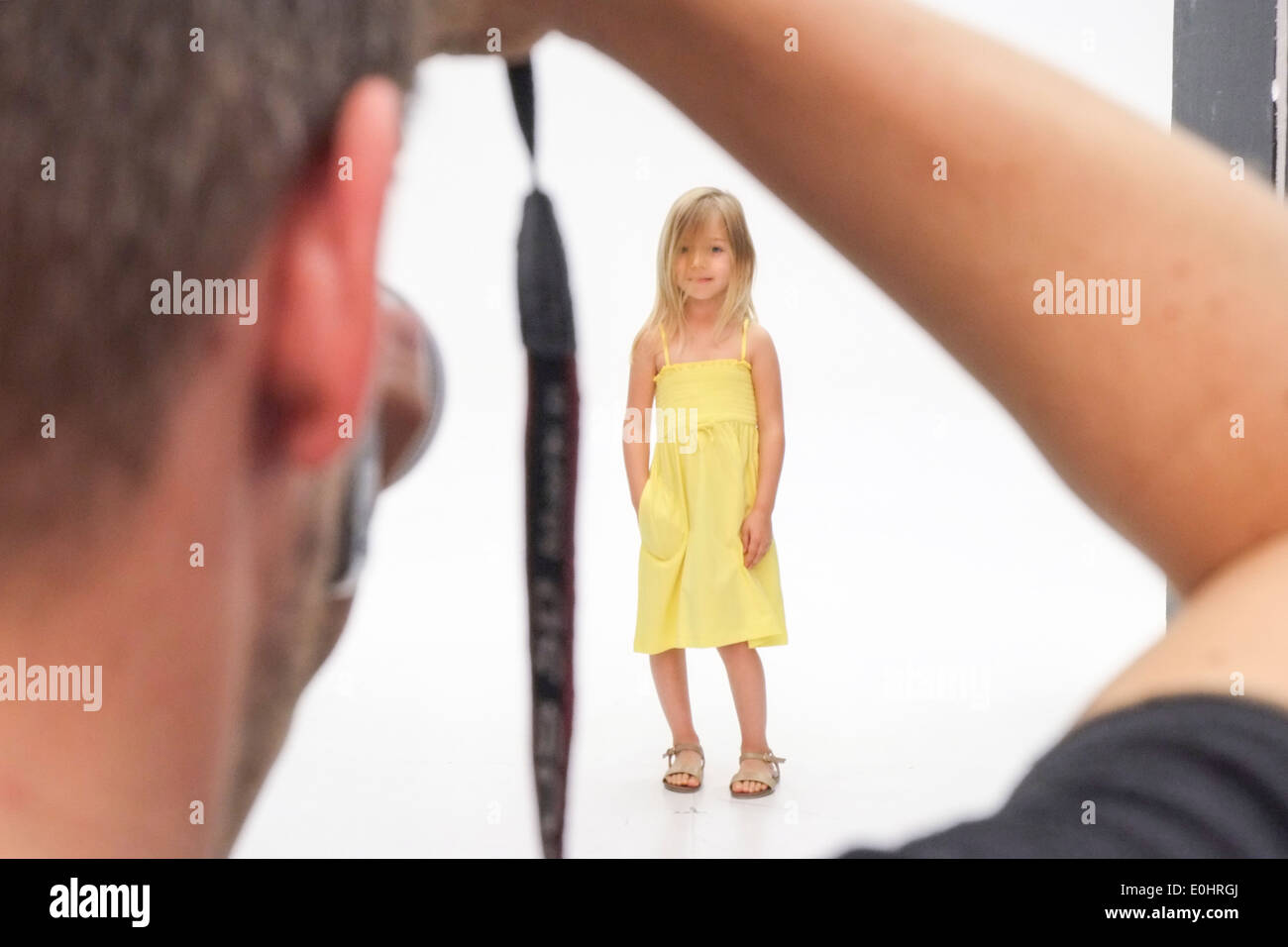 Young female child during a photoshoot for a fashion company - Stock Image