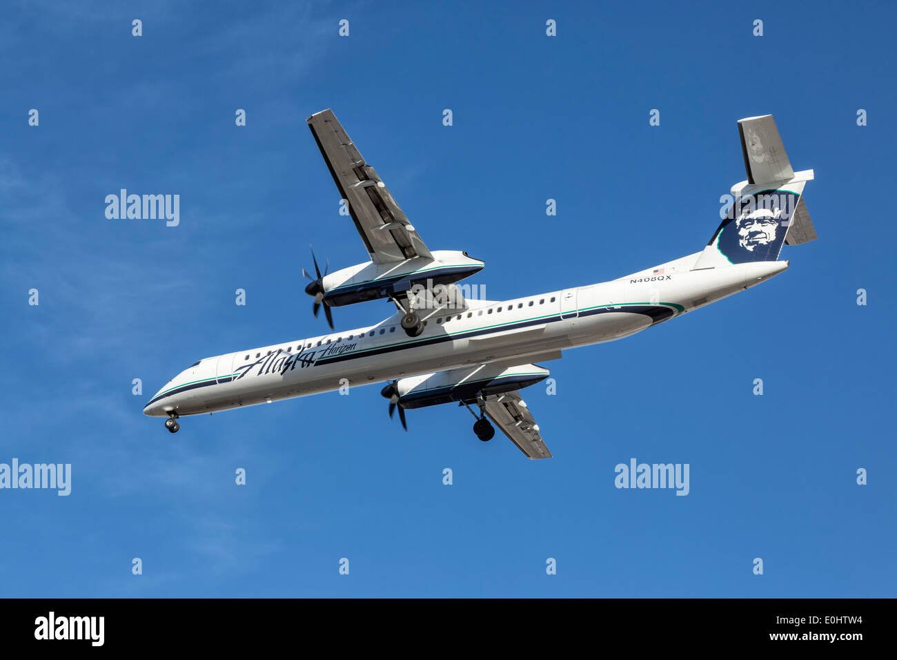 Bombardier Dash 8 of Alaska airlines on final approach - Stock Image